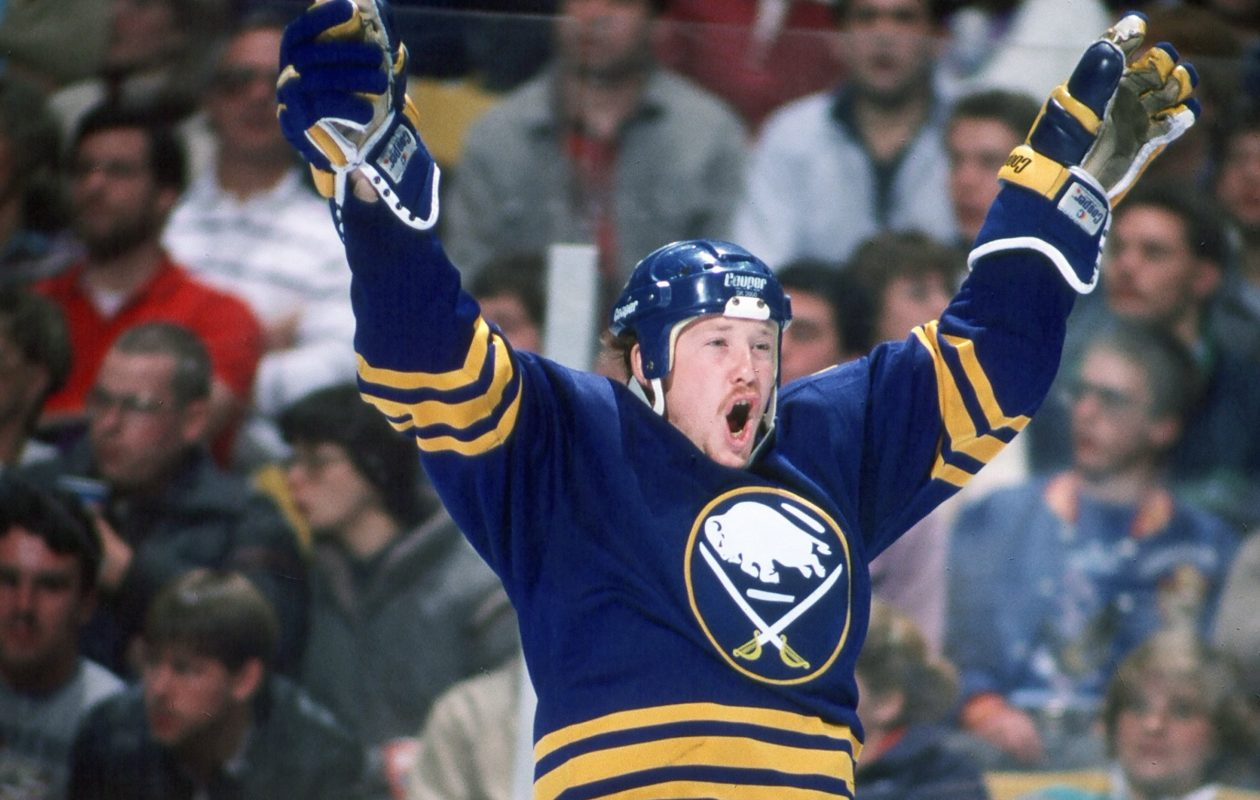 Sabres coach Phil Housley was one of the Buffalo Sabres' top draft picks of all time. Here, he celebrates a goal against the Boston Bruins at Boston Garden. (Photo by Steve Babineau/NHLI via Getty Images)