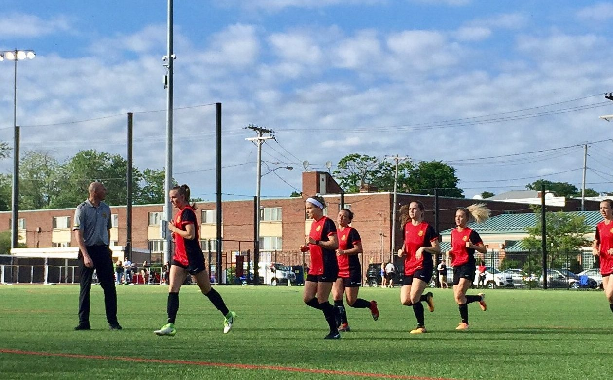 Western New York Flash jog off the field following warmups against the Long Island Rough Riders. (Ben Tsujimoto/News file photo)