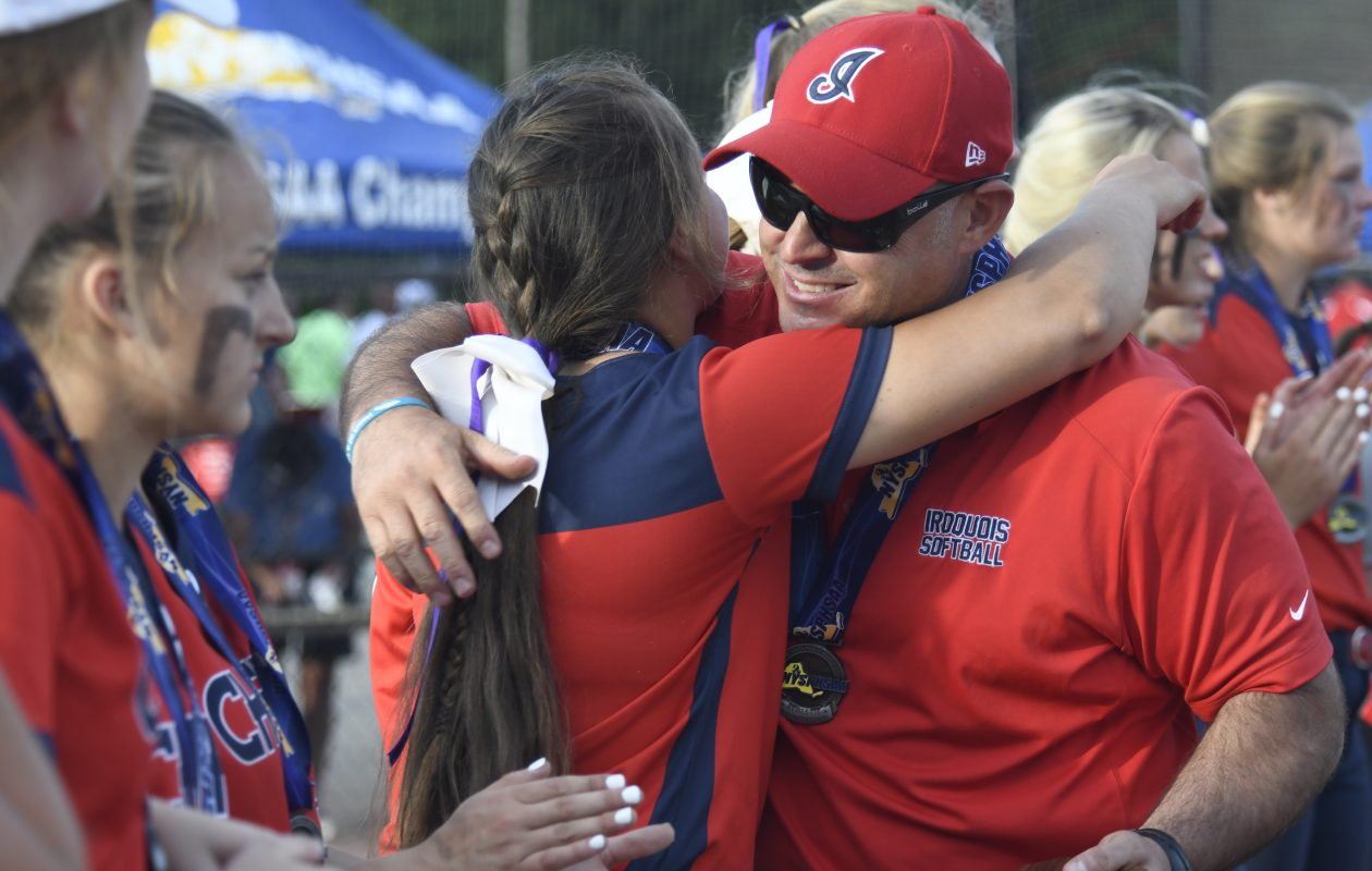 Iroquios's Olivia Simon hugs coach Aaron Vanderlip as he congratulates his team for a great season in spite of the loss to Maine-Endwell during the Class A final (Jenn March, Special to Buffalo News)