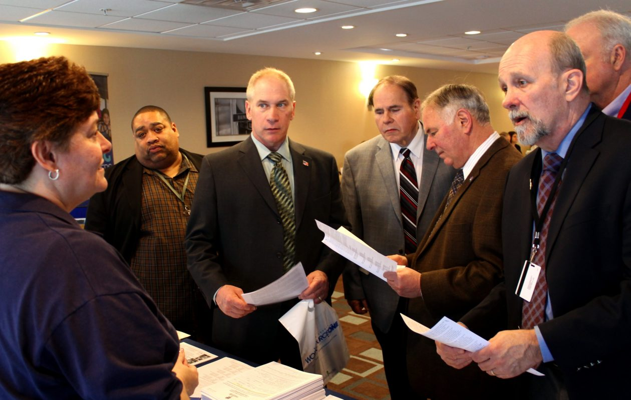 At a March 28, 2018, job fair in Niagara Falls, Roxane Albond of Opportunities Unlimited speaks with Niagara County legislators Owen Steed, Will Collins, W. Keith McNall, and Tony Nemi, and at far right, county Employment and Training Director Donald Jablonski. (Contributed photo)
