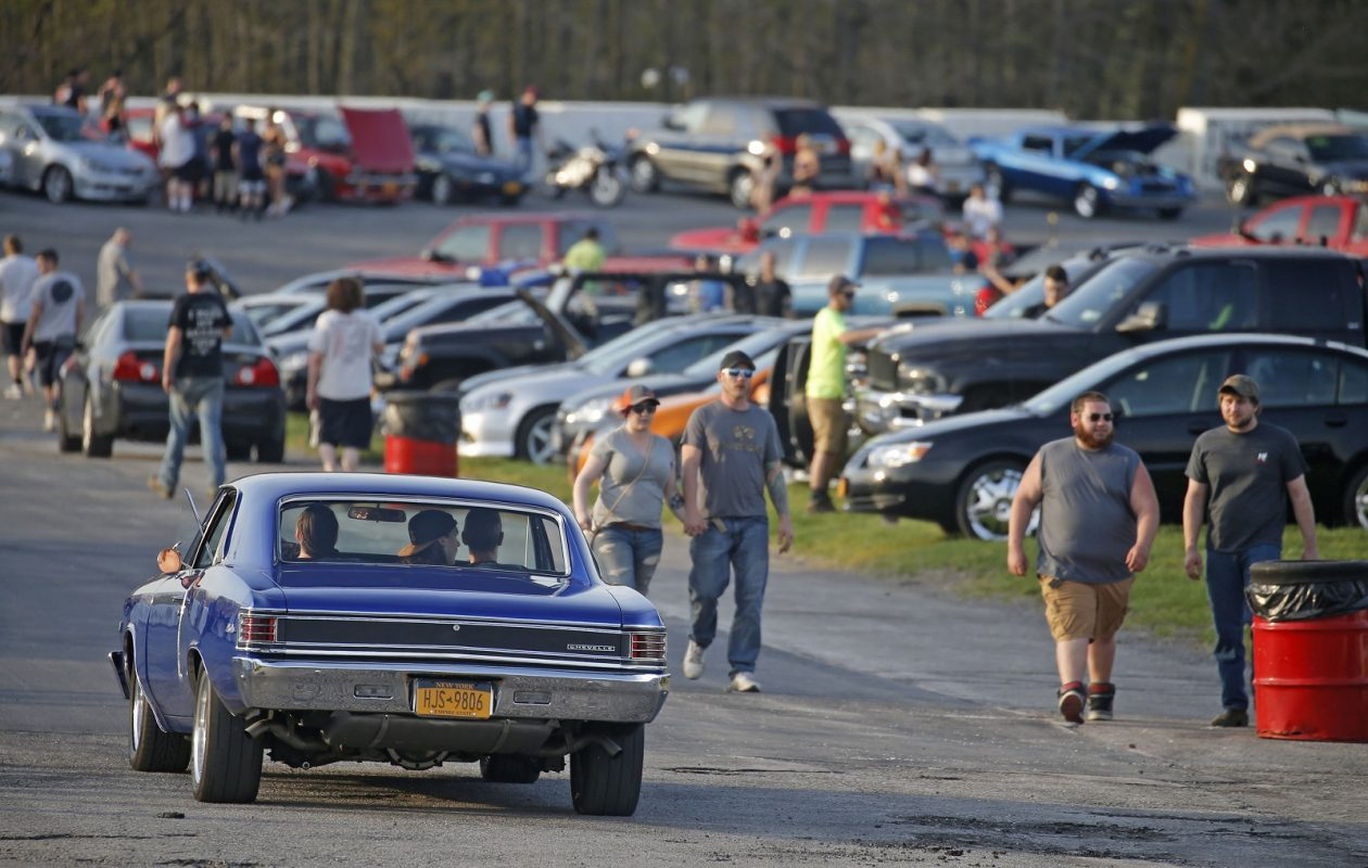 Drag racing fans in the infield follow the racing during the weekly Wednesday 'Cruise Night and Grudge Drags' at Lancaster National Speedway. (Robert Kirkham/Buffalo News)