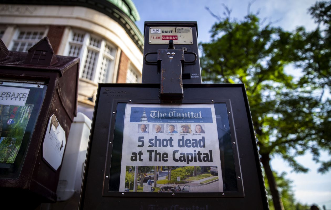 The front page of the Capital Gazette reported the massacre the morning after a gunman attacked the newsroom, in downtown Annapolis, Md. Five people were killed and two others were injured Thursday in the shooting at the community newspaper.  (New York Times)