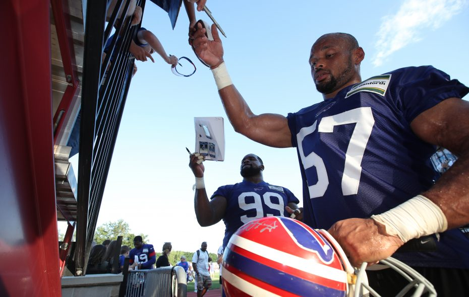 Buffalo Bills outside linebacker Lorenzo Alexander (57) signs autographs after the first day of the Bills 2017 training camp at St. John Fisher College in Pittsford on Thursday, July 27, 2017.  (James P. McCoy/Buffalo News)