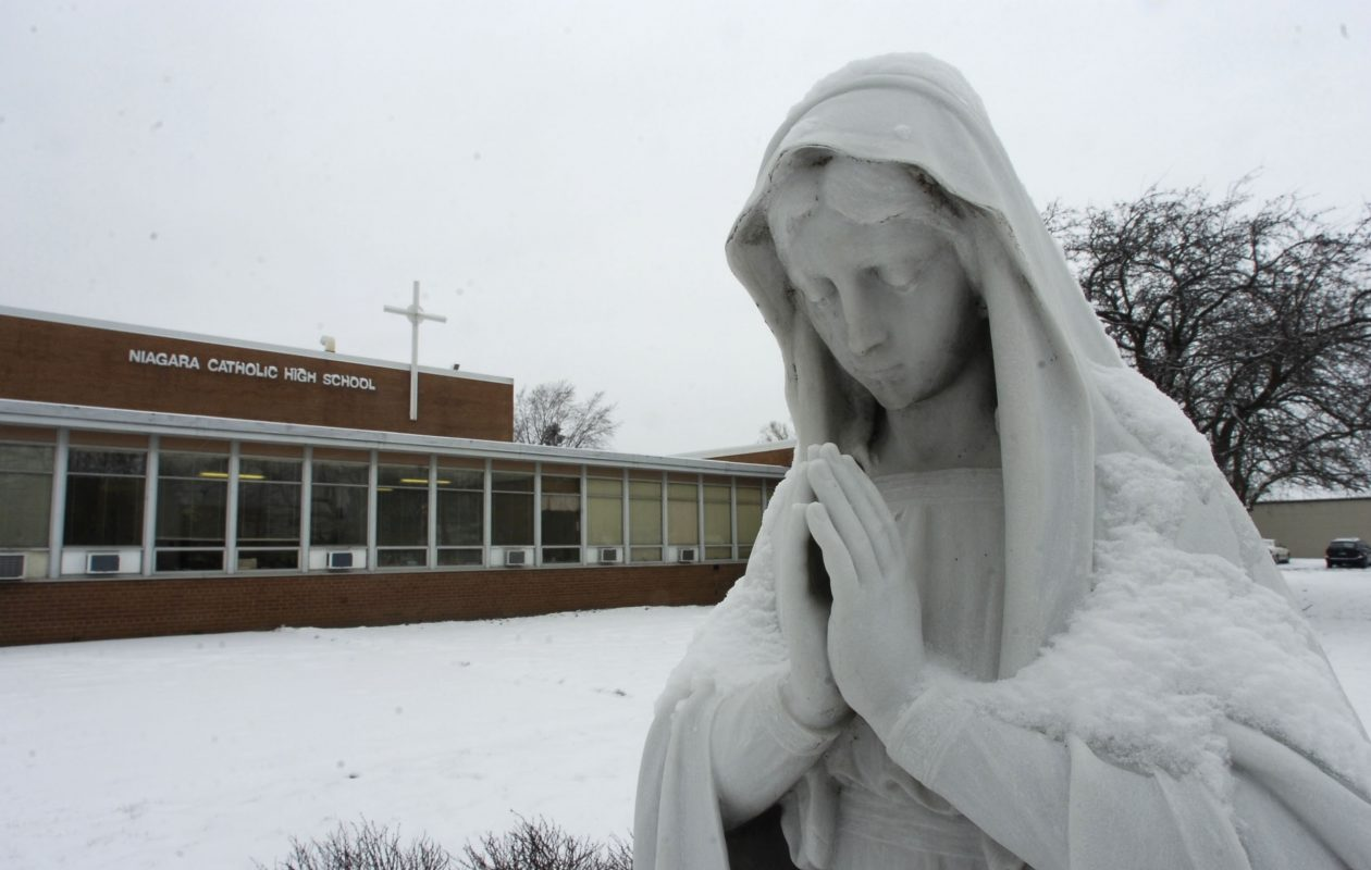 This statue of Mary, seen outside Niagara Catholic High School on Jan. 24, 2007, has been acquired by St. Peter's Church in Lewiston and will not be available at Saturday's auction. (Harry Scull Jr./News file photo)