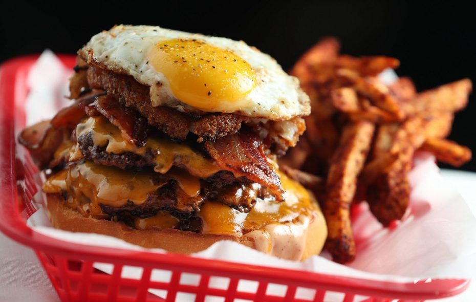 Stack Burger offers The Hangover. Burgers are topped with thick-cut bacon, cheese, crispy hashbrowns and a sunny-side-up egg. (Sharon Cantillon/News file photo