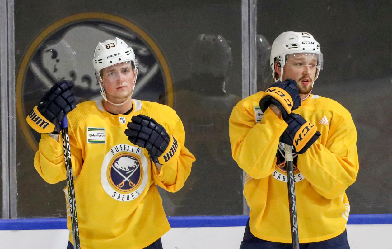 Rasmus Asplund #74 and Linus Weissbach #63 of the Buffalo Sabres take a break from drills during day three of Sabres development camp at HarborCenter in Buffalo, NY on Friday, June 29, 2018.  (James P. McCoy/Buffalo News)