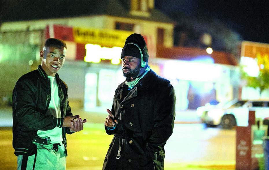 """Director Gerard McMurray, right, discusses a scene with actor Joivan Wade during filming of """"The First Purge"""" in Buffalo. (Annette Brown/Universal)"""