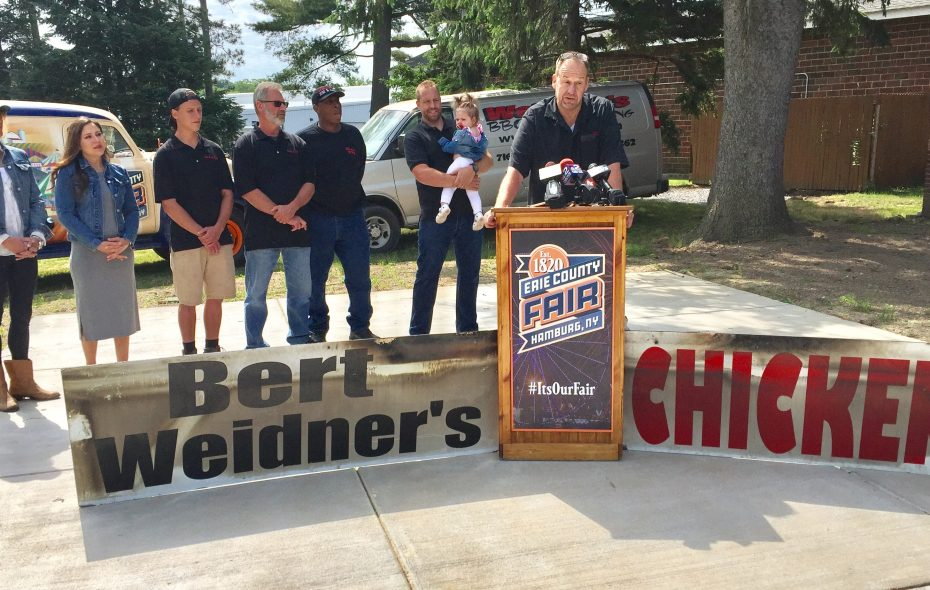 The Weidner family and staff gather as Charles Gerber talks about the stand's return to the Erie County Fair. (Barbara O'Brien/Buffalo News)