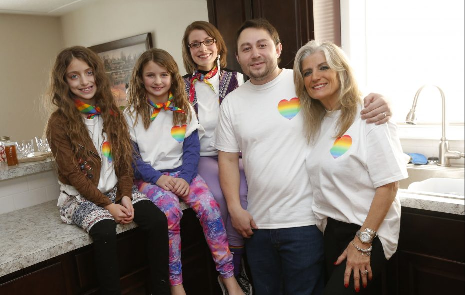 """Will Mason was inspired to write """"The Boy with the Rainbow Heart,"""" an LGBT book for children, by his own family's experiences. Here he is at his Cheektowaga home with his sister Jessica Lowell Mason, center, and mother Susan Pazzaglia. At left are Jessica's daughters Darah, 10, and Elanah, 8. (Robert Kirkham/Buffalo News)"""