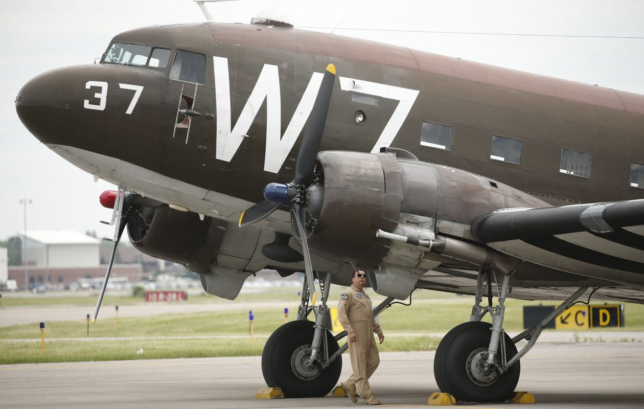 Pilot Todd 'Beedo' Cameron inspects a  C-47 that dropped paratroopers over Normandy during D-Day. The plane is at this weekend's Thunder of Niagara Air Show, which reached capacity Sunday. (Derek Gee/Buffalo News)