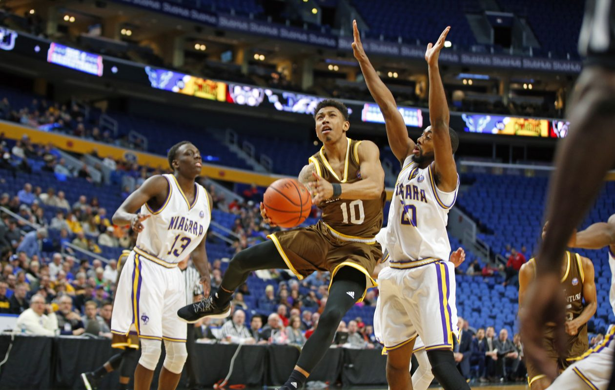 St. Bonaventure's Jaylen Adams drives to the basket against Niagara during first half action at the Big 4 classic at the Key Bank Center on Saturday, Dec. 17, 2016. (Harry Scull Jr./Buffalo News)