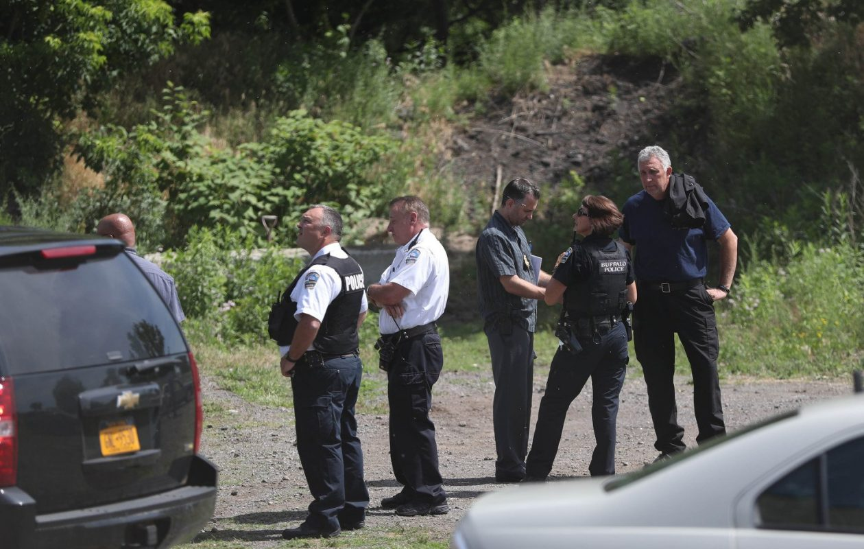 Buffalo police on the scene where the body of a black male was found in the Buffalo River at the South Park bridge. (Sharon Cantillon/Buffalo News)