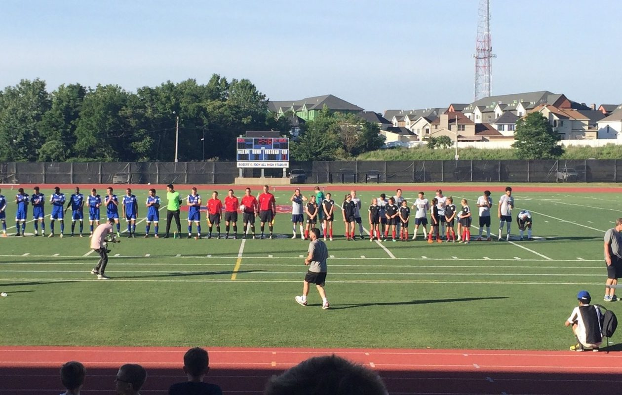 Erie Commodores, in blue, and FC Buffalo line up for introductions before the NPSL clash. (Ben Tsujimoto/Buffalo News)