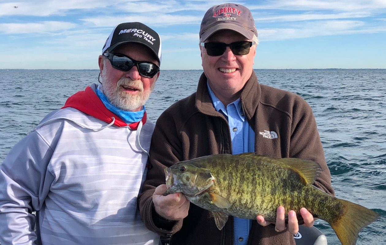 Steve Garvin of Angola with a 5-pound Lake Erie smallmouth bass he caught in 38 feet on a tube.Steve Garvin of Angola with a 5-pound Lake Erie smallmouth bass he caught in 38 feet on a tube.