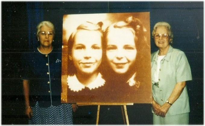 Gathie Barnett Evans and Marie Barnett Snodgrass at Jamestown's Robert H. Jackson Center, 2006, with a photograph of themselves as children during the landmark Supreme Court case involving the Pledge of Allegiance in 1943. (Photo courtesy of the Robert H. Jackson Center)