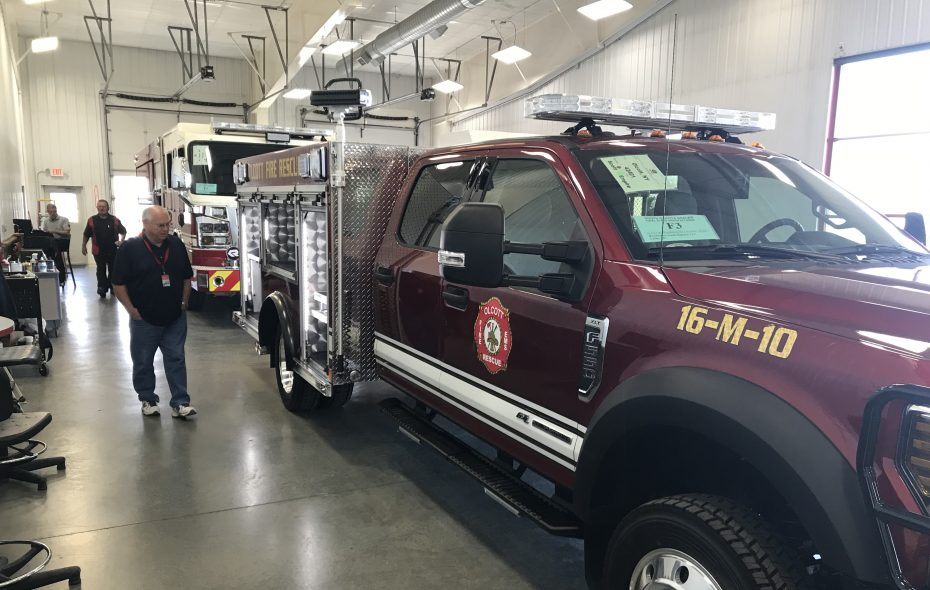 Olcott firefighter Robert Murray checks out the Olcott Fire Company's new truck. (Contributed photo)