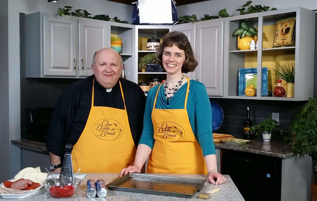 Among the programs on the Buffalo Catholic Diocese's Daybreak TV was 'Our Daily Bread,' with host Rev. Paul D. Seil shown in a provided file photo with Kathryn Goller, director of Youth and Young Adult Ministry for the diocese.