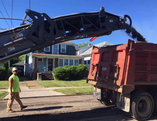 Workers have begun milling and paving Arden Avenue, one of 103 residential streets citywide included in the 2018 residential paving and sidewalk work season in Buffalo. (Deidre Williams/Buffalo News)