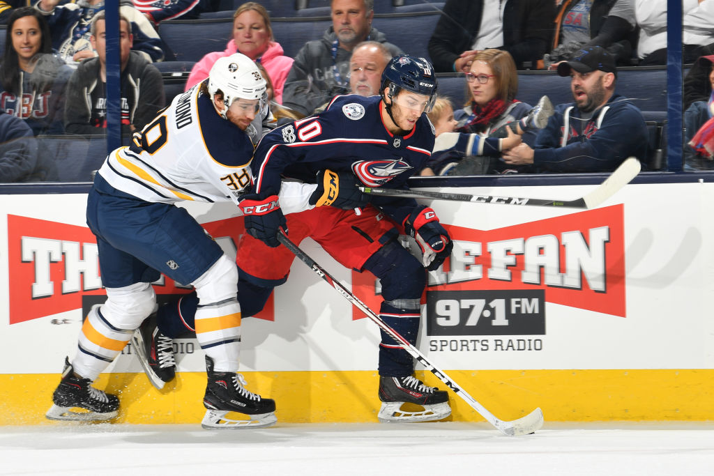 Zach Redmond led the Amerks in scoring and played three games for the Sabres last season. (Getty Images)