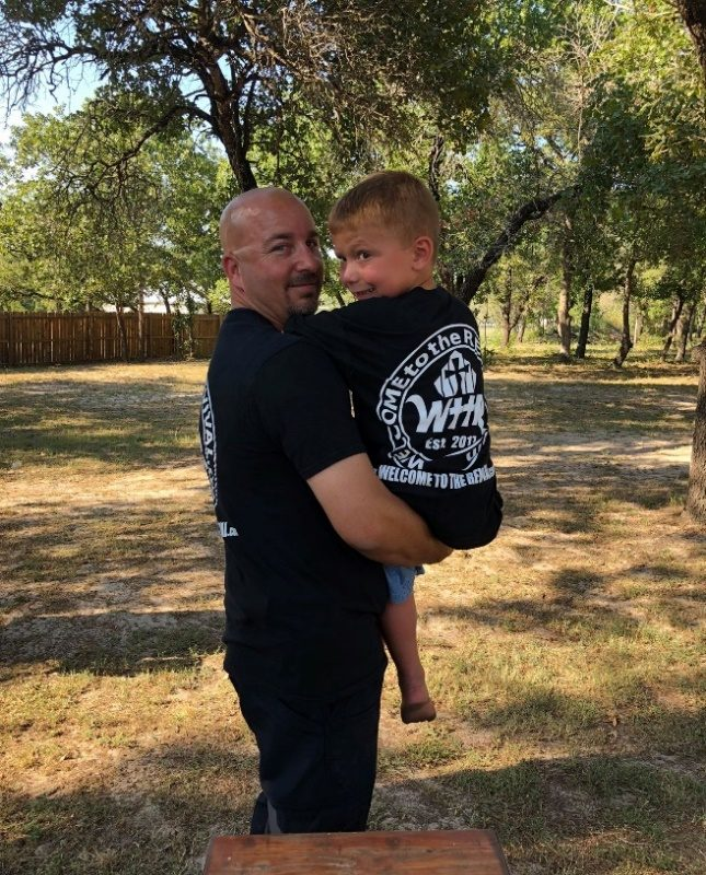 Ryland Ward, right, and Rusty Duncan, the firefighter who rescued him, model Welcome to the Revival t-shirts. (Contributed photo).
