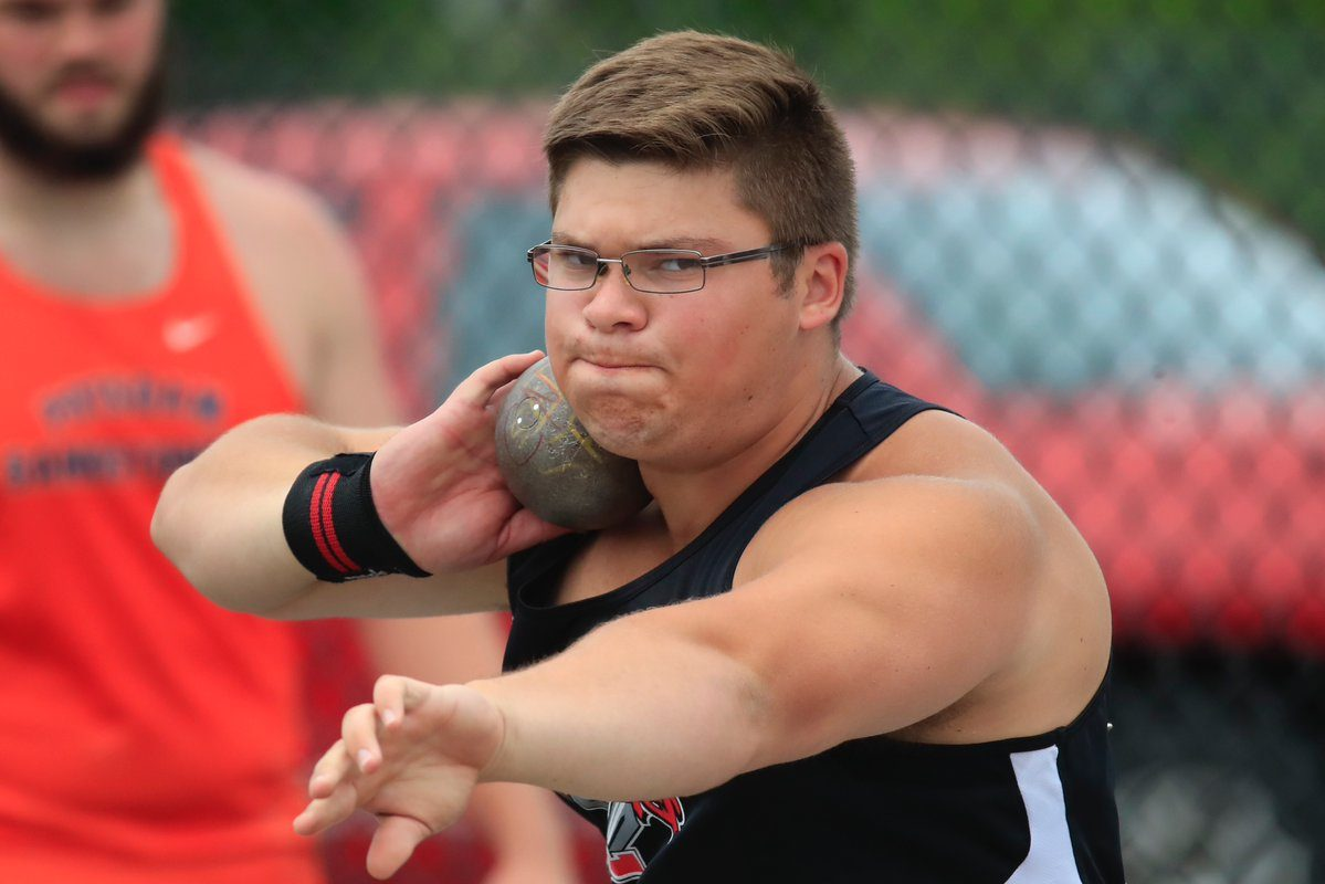 Jon Surdej of Lancaster unleashes his winning throw during the Federation shot put championship competition Saturday at Cicero-North Syracuse. (Harry Scull Jr./Buffalo News)