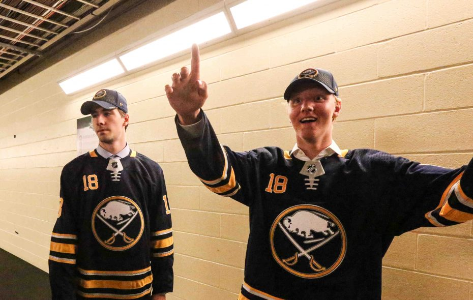 An excited Rasmus Dahlin welcomes the Sabres' second-round pick, Mattias Samuelsson, who was absorbing the moment. (James P. McCoy/Buffalo News)