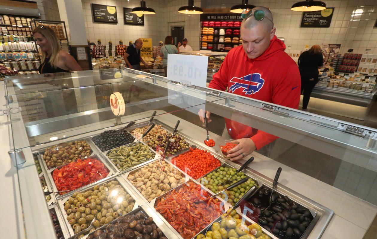 Patrick Ott, of Tonawanda shops at Whole Foods Market in Amherst. (John Hickey/Buffalo News)