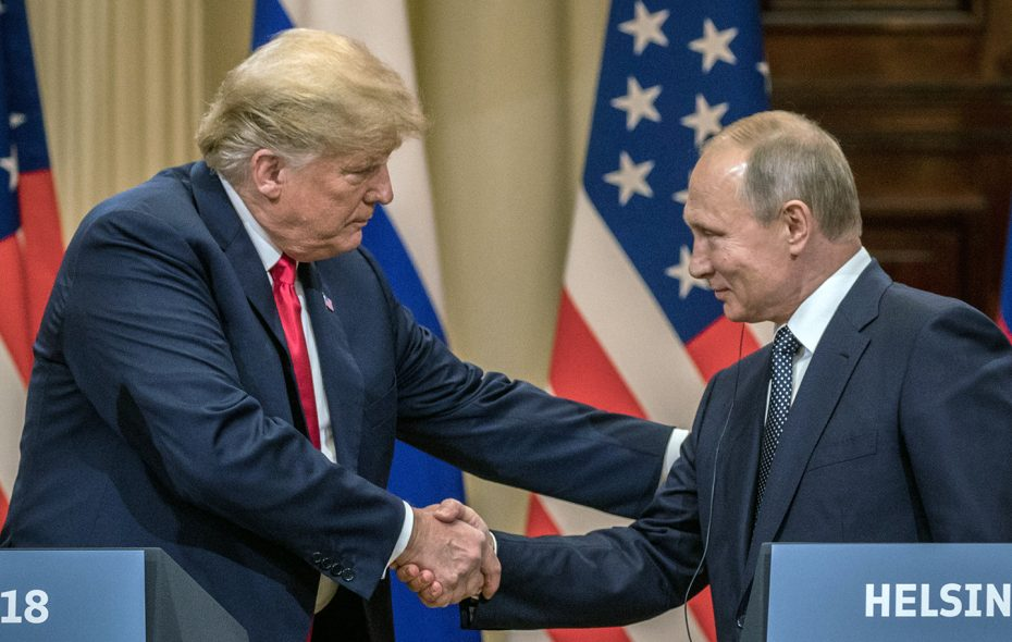 U.S. President Trump and Russian President Vladimir Putin shake hands during a joint news conference after their summit July 16 in Helsinki, Finland. (Getty Images)