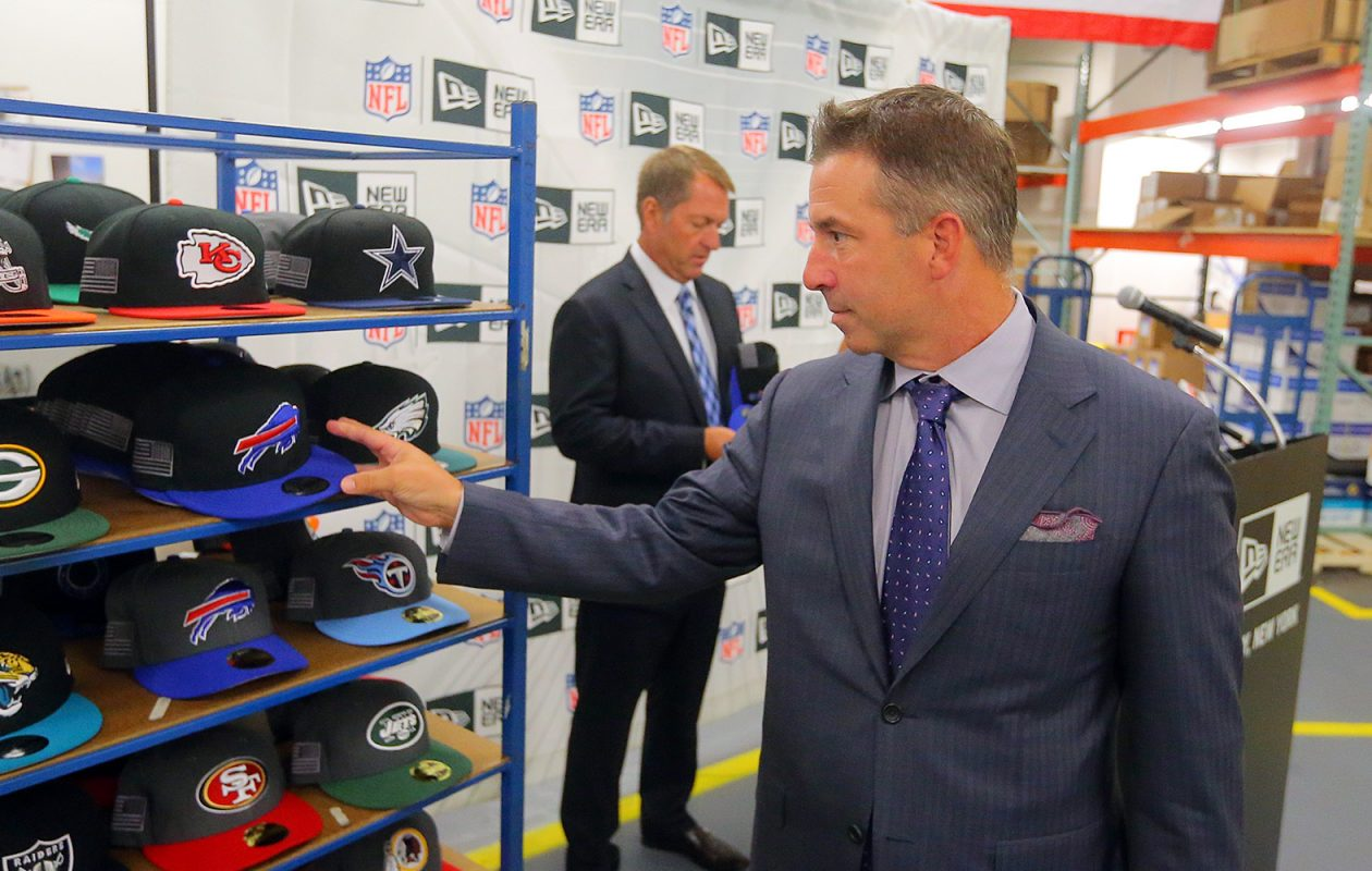 Russ Brandon, foreground, has a longstanding relationship with New Era Cap Co. CEO Chris Koch, background. (John Hickey/News file photo)