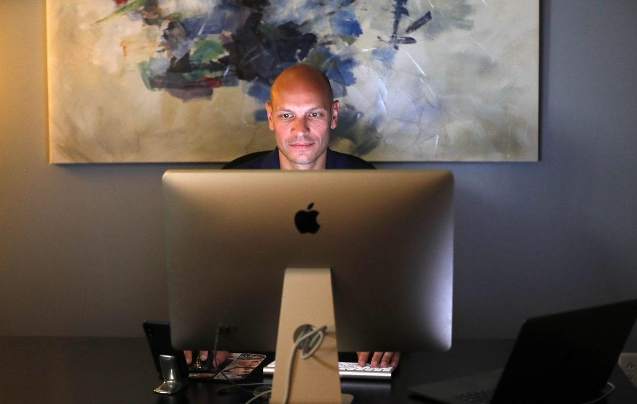 Michael Ginnitti runs the Spotrac website, a popular destination for fantasy sports fans and professional agents, from his office in Orchard Park. (Mark Mulville/Buffalo News)