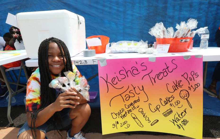 Mikeisha Frazier shows off the cake pops and other goodies she sells as part of the Youth Entrepreneurship Marketplace each Saturday on Fillmore Avenue. (Sharon Cantillon/Buffalo News)