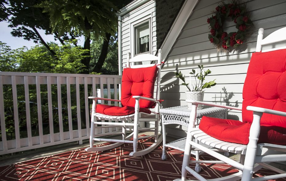 Stephen and Rebecca Parisi's cozy front porch in Williamsville is decorated in red and white. (Shuran Huang/Buffalo News)