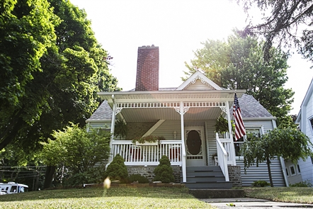 Summer days call for porches like the  one at Stephen and Rebecca Parisi's house.