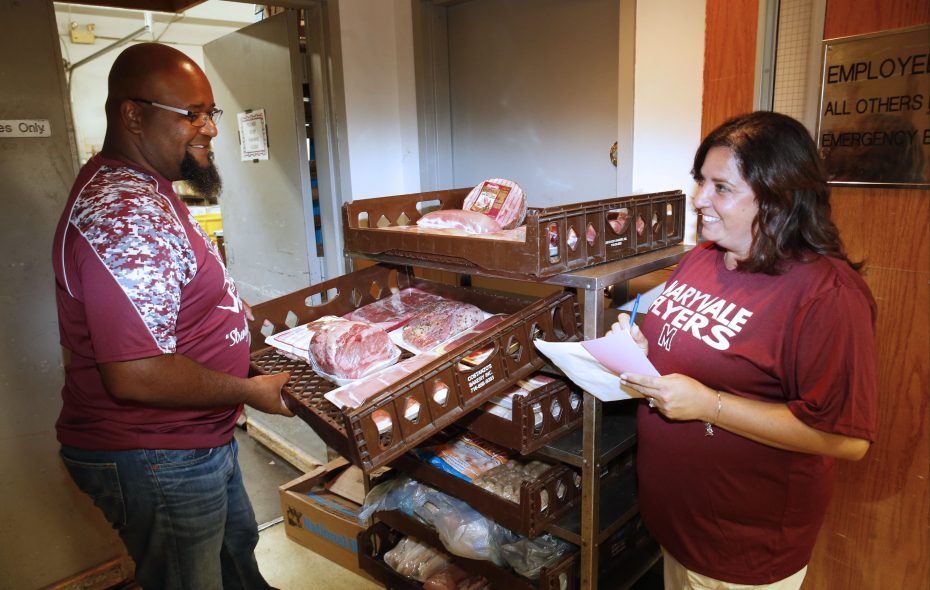 As you might expect, a  variety of meats are raffled off. Volunteers Tina and  Lloyd Gray sort meat at a raffle to benefit the Maryvale High School cheerleading program. (Robert Kirkham/Buffalo News)