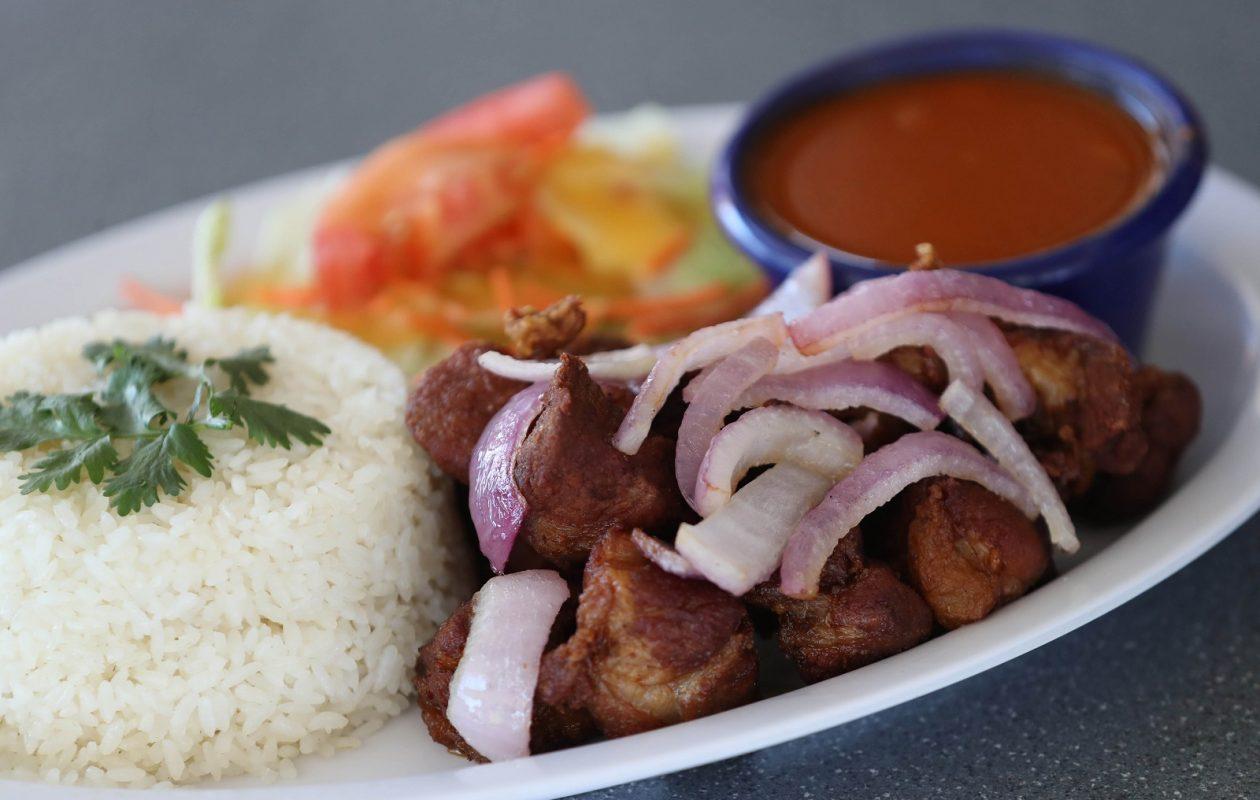 Niagara Cafe's carne frita is fried pork, with rice, salad and beans. (Sharon Cantillon/Buffalo News)