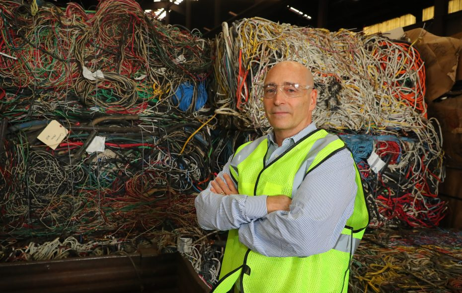 Brian Shine, president of Manitoba Corp., stands by scrap wire awaiting recycling at his plant in Lancaster. (John Hickey/Buffalo News)