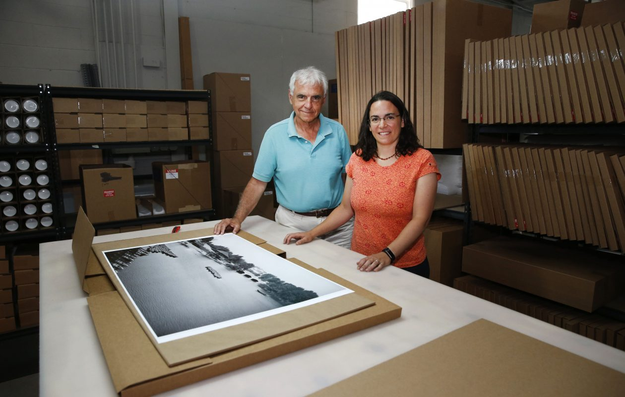 Daughter Sara Saak, chief marketing officer, right, and George Campos, founder and president want nothing but professional results for their clients. George Campos started a darkroom rental lab in 1979 and evolved through the years as the needs of photographers changed.  (Robert Kirkham/Buffalo News)