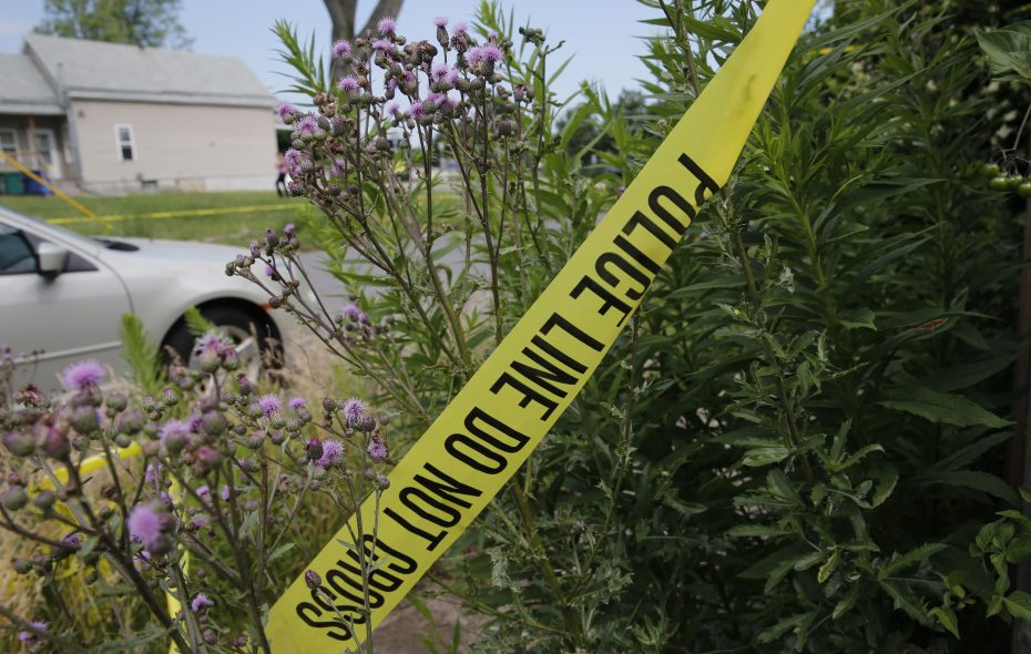 Police crime scene tape on Grape Street where shooting early Monday claimed two lives, including a 17-month-old, July 2, 2018. (Derek Gee/Buffalo News)