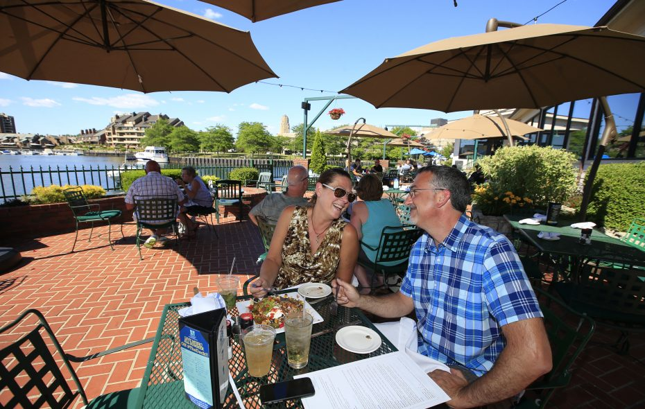 Dave and Dorie Loschiavo enjoy drinks and dinner on the patio at Templeton Landing. (Harry Scull Jr./ Buffalo News)