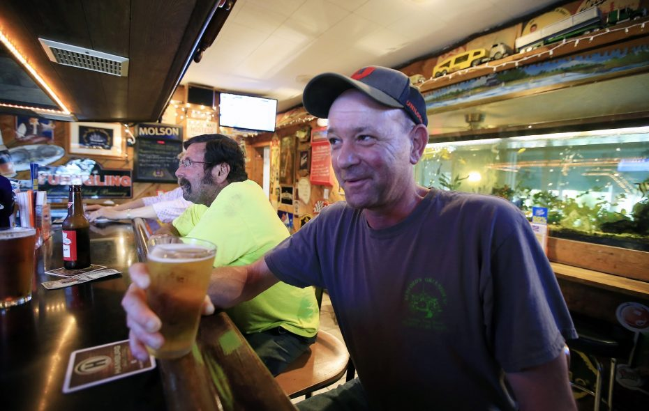 AJ Lang enjoys a beverage at Ship n' Shore restaurant near Tonawanda Creek. (Harry Scull Jr./ Buffalo News)