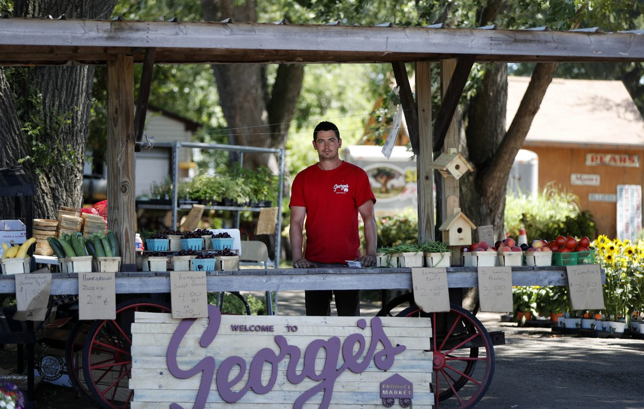 Michael Pope of George's Produce Market at his stand on Monday, July 9, 2018. (Mark Mulville/Buffalo News)