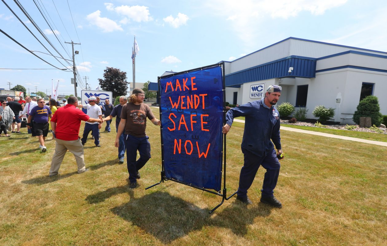 Dennis Rush and Zackery Krajewski were among unionized employees who highlighted a report critical of health and safety conditions at Wendt Corp. in Cheektowaga at a rally Thursday. (John Hickey/Buffalo News)