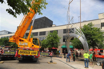 Local sculptor Jesse Walp's new sculpture, based on the flowing waters of Niagara Falls, arrives at Old Falls and First streets in downtown Niagara Falls on Friday, July 13, 2018. The towering sculpture was installed in the spot where millions of tourists visit each year.