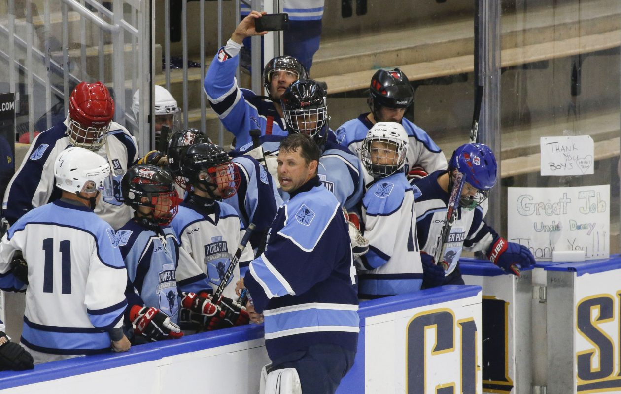 Former Sabres goalie Marty Biron visits with the ROAR Logistics bench before playing with the Sabres Alumni/Buffalo Beauts team on the final day of the 11 Day Power Play Community Shift at HarborCenter on Sunday, July 15, 2018. (Derek Gee/Buffalo News)