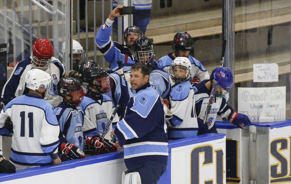 Former Sabres goalie Marty Biron visits with the ROAR Logistics bench before playing with the Sabres Alumni/Buffalo Beauts team in the 2018 11-Day Power Play. (Derek Gee/News file photo)