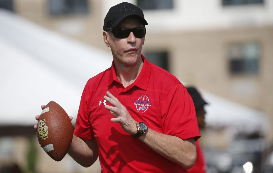 Hall of Fame quarterback Jim Kelly throws the ball while running drills with participants in his Jim Kelly Football Clinic at St. John Fisher College in Pittsford on Tuesday, July 17, 2018. (Derek Gee/Buffalo News)