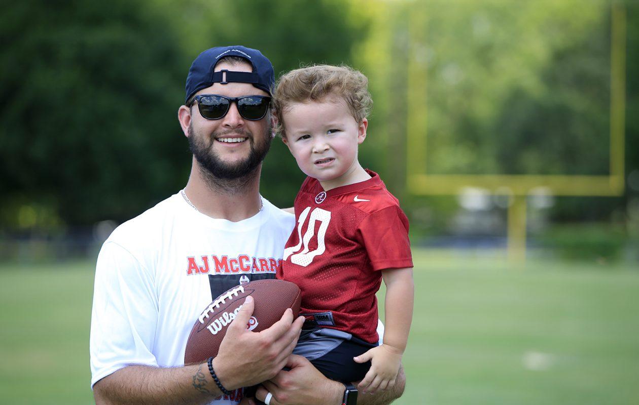 AJ McCarron and his son Raymond III. (Harry Scull Jr./Buffalo News)