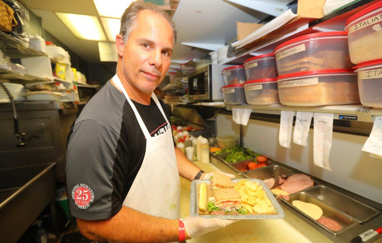 Chris Vendetti, owner of Chris's Sandwich Shop,  makes a Roast Beef Slawich. (John Hickey/Buffalo News)