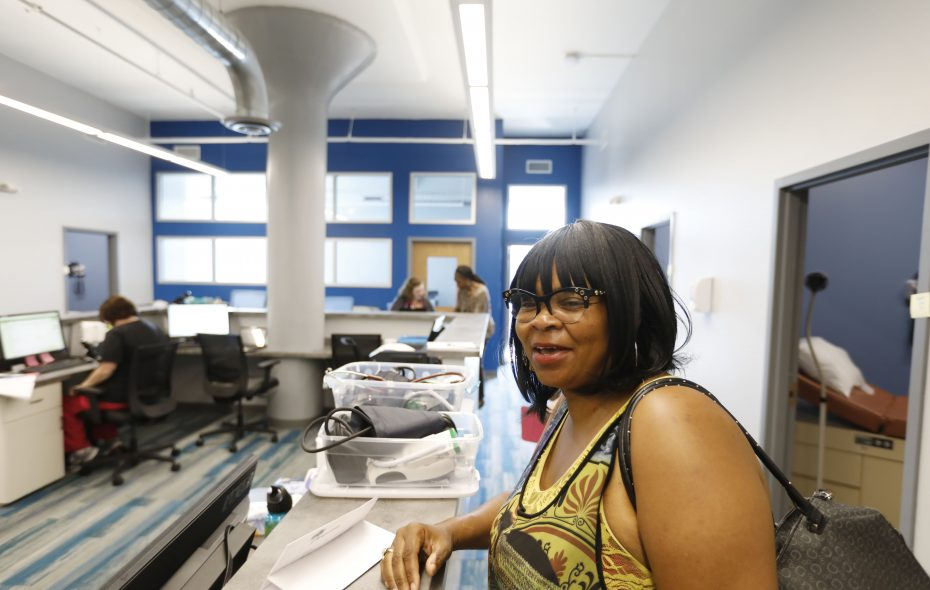 New patient Carmen Moody stops at the nurse's station after her appointment in the new Jericho Road Community Health Center on Broadway next to the Broadway Market on July 19, 2018. (Derek Gee/Buffalo News)