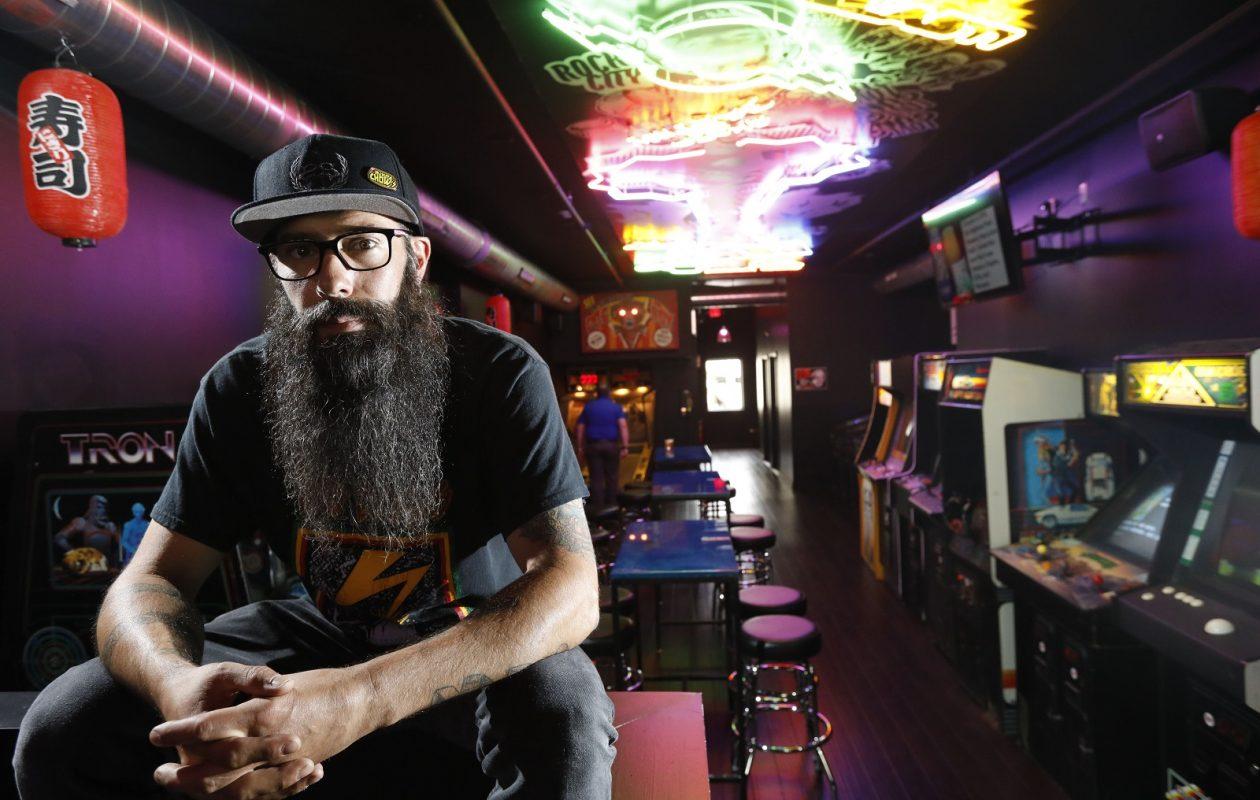 Heavy metal rocker Johny Chow has created an unusual restaurant and arcade with his new Misuta Chow's at 521 Main St. (Derek Gee/Buffalo News)